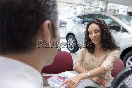 salesman and young woman sitting at