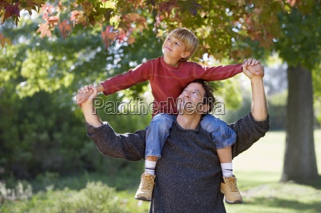 father carrying son 7 9 on