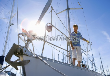 man standing on deck of moored