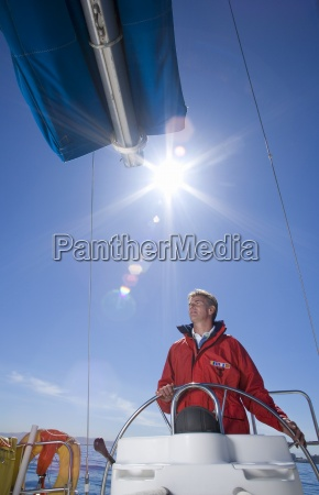 man in red jacket standing at