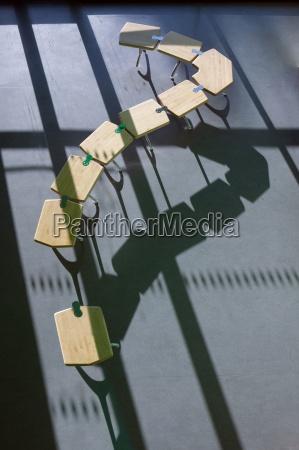 row of school desks formed into