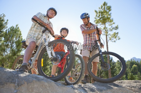 three generations of men riding mountain