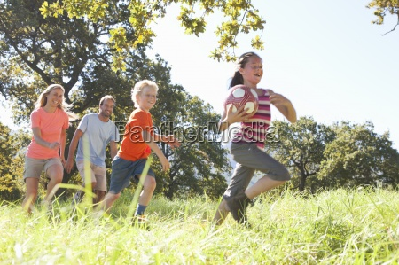 parents and children running with ball