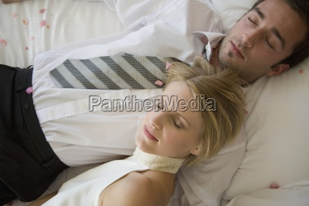 day indoors man woman lying down