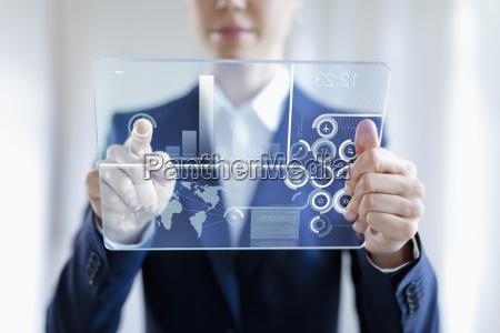 digital tablet graph pointing finger virtual