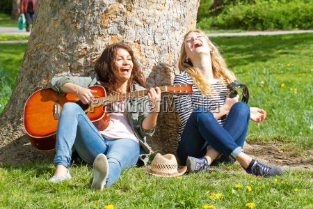 two girlfriends making music in the