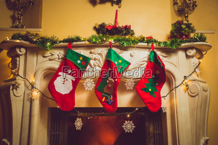 toned photo of three red christmas