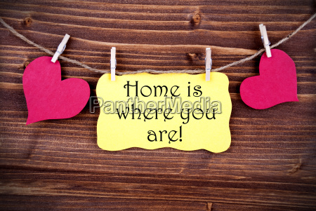 yellow lable saying home is where