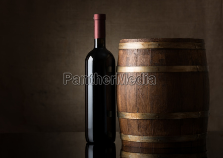 bottle and a wooden barrel