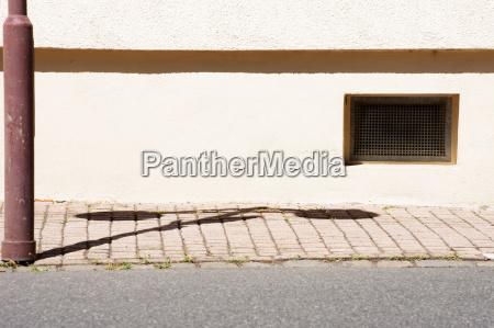 basement window with lantern shadow