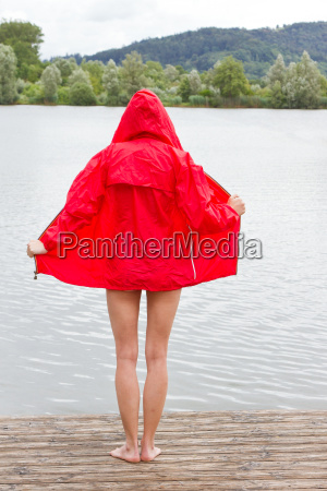 young woman in red jacket by