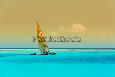 wooden sailboat on water