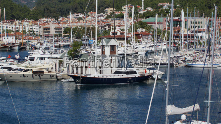 beautiful white sailing vessels docked in