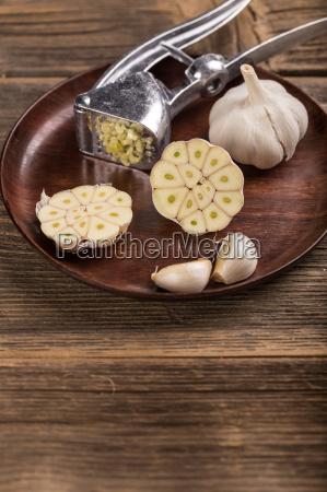 garlic bulb clove and press on