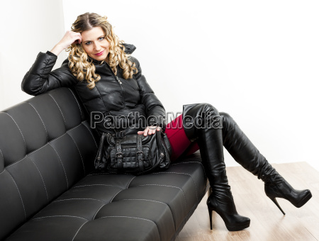 woman wearing fashionable clothes sitting with