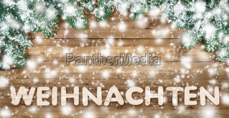 snowy christmas in wooden letters