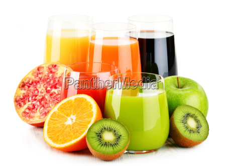 glasses of assorted fruit juices isolated