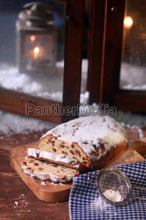 tasty sweet sliced bread on wooden