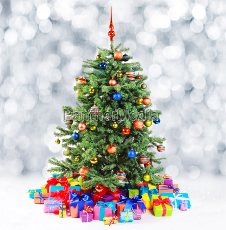 colorful family christmas tree with falling