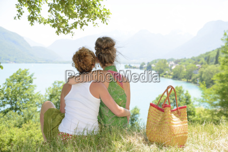 two lesbians in nature admire the
