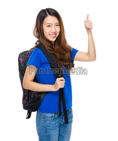 student with backpack and thumb up