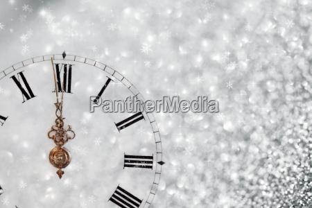 old clock with stars snowflakes and