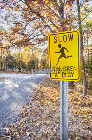yellow slow children at play road