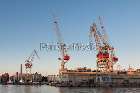 sea port cranes with blue cloudy