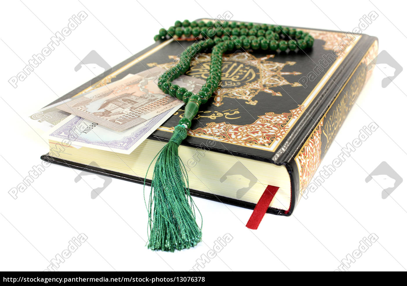 defeated, koran, with, pakistani, currency - 13076378