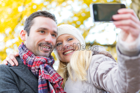 young attractive couple taking selfie in