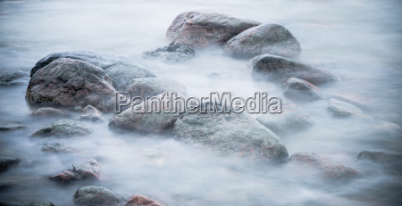 marine stones washed by a wave