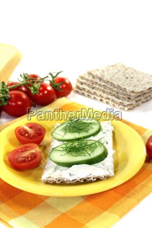 crispbread with cream cheese and tomato