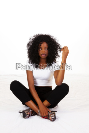young african american teen sitting looking