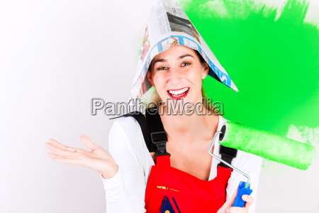 woman having fun while painting the