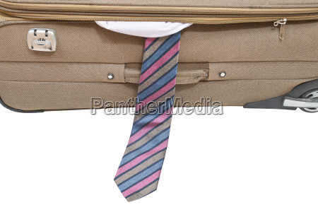 male tie from ajar suitcase isolated