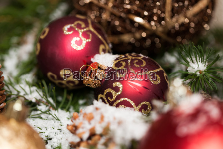 red christmas baubles between cones and