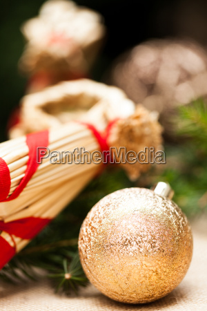 golden christmas baubles glittering on fir