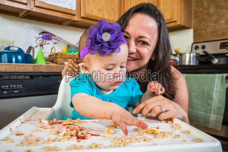 mother smiles with baby