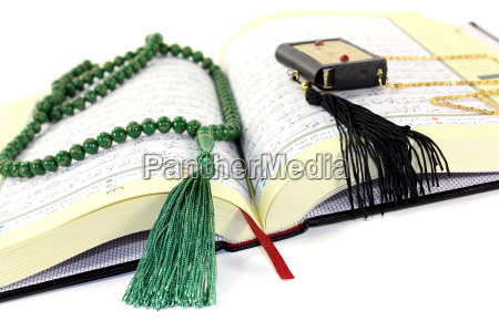 whipped, koran, with, green, rosary - 13135950