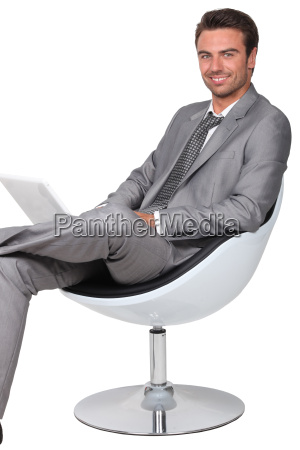 businessman in a swivel chair