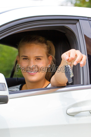 young motorist with key in hand