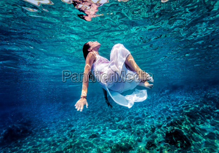 gorgeous female dancing underwater