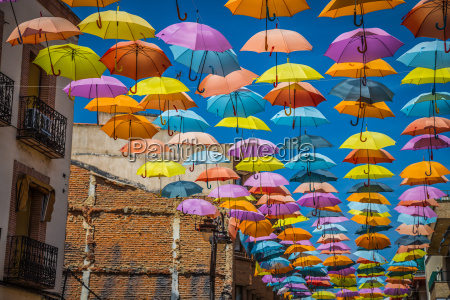 street decorated with colored umbrellas madrid