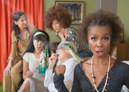 disappointed woman with group smoking pot