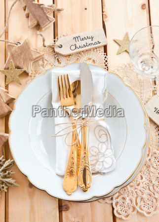 setting with golden cutlery