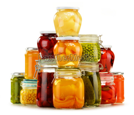 jars with pickled vegetables fruity compotes