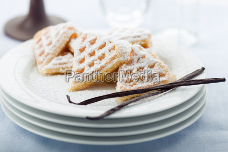 freshly baked heart waffles with powdered
