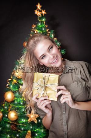 cute female near christmas tree