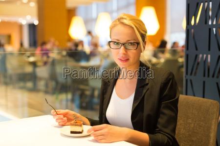 women eating dessert in fancy restaurant