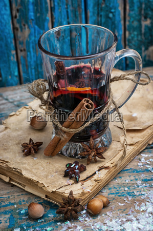 glass mulled wine with spices in